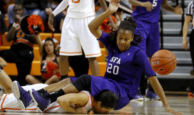 OKLAHOMA STATE UNIVERSITY WOMEN'S BASKETBALL / OSU WOMEN'S BASKETBALL: Stephen F. Austin's Antionette Carter (20) lands on top of Oklahoma State's Brittney Martin (22) during a women's college basketball game between Oklahoma State University and Stephen F. Austin at Gallagher-Iba Arena in Stillwater, Okla., Thursday, Dec. 6, 2012.  Photo by Bryan Terry, The Oklahoman