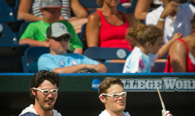 Mississippi's Evan Anderson, left, and Brantley Bell dress up like Harry Potter late in an NCAA College World Series baseball game against Virginia in Omaha, Neb., Saturday, June 21, 2014. (AP Photo/The World-Herald, Brendan Sullivan) MAGS OUT, TV OUT