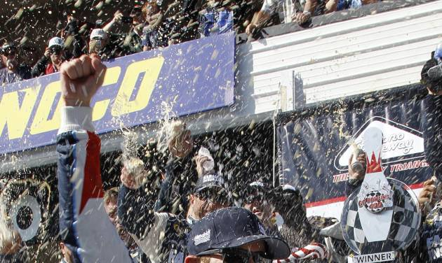 Kasey Kahne celebrates in victory lane after winning a NASCAR Sprint Cup Series auto race, Sunday Aug. 4, 2013, at Pocono Raceway in Long Pond, Pa. Jeff Gordon was second. (AP Russ Hamilton Sr.)