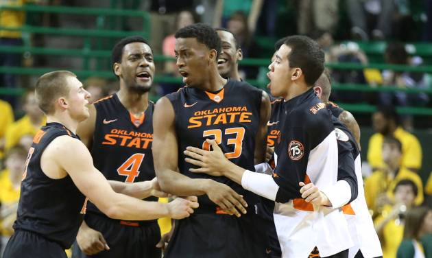 OSU players surround Leyton Hammonds, center, after he hit a shot sending the game against Baylor to overtime on Monday in Waco, Texas. Baylor won 70-64. AP Photo