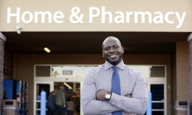 """This photo taken Nov. 21, 2013 shows James Lott outside the Wal-Mart store where he works as a pharmacist in Bonney Lake, Wash. Lott, who lives in Renton, Wash., a suburb of Seattle, adds significantly to his six-figure job salary by day-trading stocks. It's not just the wealthiest 1 percent: Fully 20 percent of U.S. adults become rich for parts of their lives, wielding outsized influence on America's economy and politics. And this little-known group may pose the biggest barrier to reducing the nation's income inequality. While the growing numbers of the U.S. poor have been well documented, survey data provided exclusively to The Associated Press detail the flip side of the record income gap: the rise of the """"new rich."""" (AP Photo/Elaine Thompson)"""