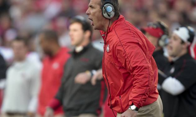 Ohio State coach Urban Meyer directs his team from the sidelines during the first half of a college football game against Wisconsin Saturday, Nov. 17, 2012, in Madison, Wis. Ohio State won 21-14 in overtime. (AP Photo/Andy Manis)