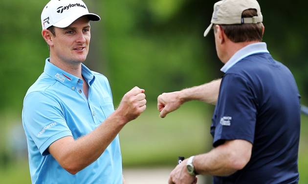 Justin Rose gets a fist bump after sinking a putt on the eighth hole during the Zurich Classic pro-am golf tournament at the TPC Louisiana on Wednesday, April 24 , 2013 in Avondale, La.  (AP Photo/Nola.com, Michael DeMocker) MAGS OUT; NO SALES; USA TODAY OUT; THE BATON ROUGE ADVOCATE OUT
