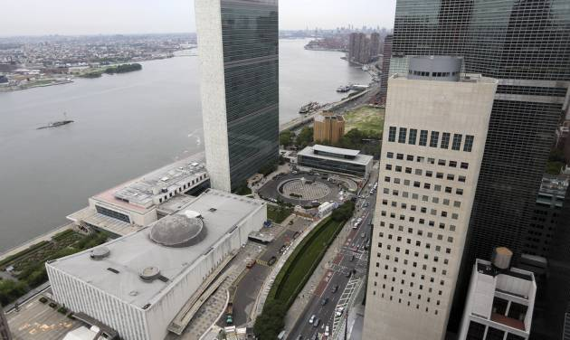 """This Thursday, July 11, 2013 photo shows the United Nations headquarters at left. Two whistle-blowers exposed evidence-tampering by a top official within the U.N. office that is supposed to investigate corruption in the world body's operations and suffered retaliation for it, a U.N. judge has ruled. The ruling and other recent opinions by the U.N. Dispute Tribunal show that the world body still struggles to hold itself accountable despite the promised reforms since a vast scandal involving its oil-for-food program with Saddam Hussein's regime in Iraq. In a ruling in December 2013, Judge Goolam Meeran said the Investigation Division's deputy director, Michael Dudley, """"admitted to altering and withholding evidence"""" in an investigation and had retaliated against the investigators assigned to the case, Florin Postica and Ai Loan Nguyen-Kropp. The United States Mission to the United Nations building in New York is at right.  (AP Photo/Mary Altaffer)"""