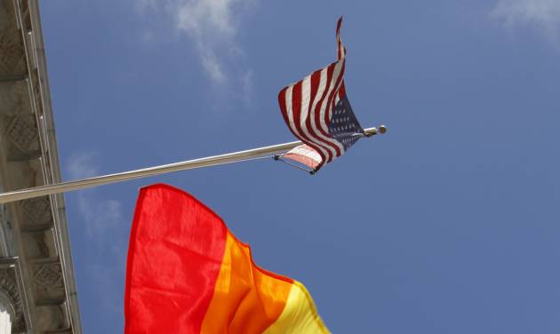 In this file photo from Thursday, Aug. 12, 2010, a rainbow flag flies below the American flag outside City Hall in San Francisco. The U.S. Supreme Court decided Friday, Dec. 7, 2012, to hear the appeal of a ruling that struck down Proposition 8, the state's measure that banned same sex marriages. The highly anticipated decision by the court means same-sex marriages will not resume in California any time soon. The justices likely will not issue a ruling until spring of next year. A federal appeals court ruled in February that Proposition 8's ban on same-sex marriage was unconstitutional. But the court delayed implementing the order until same-sex marriage opponents proponents could ask the U.S. Supreme Court to review the ruling. (AP Photo/Ben Margot)