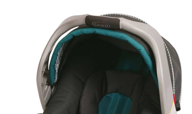 This undated photo provided by Graco Children's Products shows a SnugRide Classic Connect infant car seat. Graco Children's Products is recalling 1.9 million infant car seats, bowing to demands from U.S. safety regulators in what is now the largest seat recall in American history. Buckles can get gummed up by food and drinks, and that could make it hard to remove children. Infant-seat models covered by the recall issued Tuesday, July 1, 2014, include the SnugRide, SnugRide Classic Connect (including Classic Connect 30 and 35), SnugRide 30, SnugRide 35, SnugRide Click Connect 40, and Aprica A30. They were manufactured between July 2010 and May 2013, according to the National Highway Traffic Safety Administration. (AP Photo/Graco Children's Products)