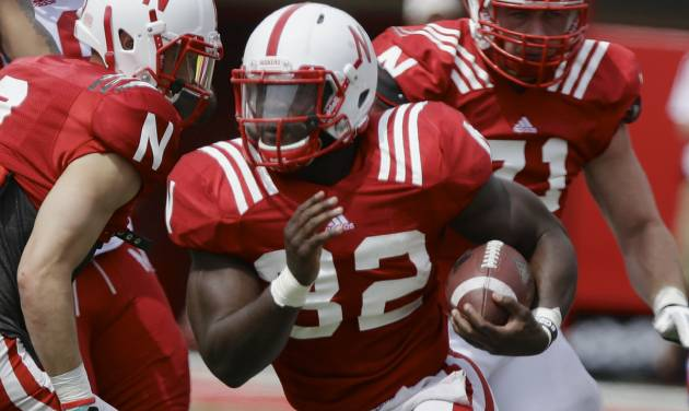 Nebraska running back Imani Cross (32) carries the ball during an NCAA college football spring game in Lincoln, Neb., Saturday, April 12, 2014. (AP Photo/Nati Harnik)