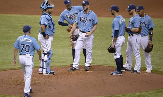 Tampa Bay Rays manager Joe Maddon (70) walks to the mound to take out starting pitcher Erik Bedard, center, during the sixth inning of a baseball game against the Houston Astros in St. Petersburg, Fla., Sunday, June 22, 2014. (AP Photo/Phelan M. Ebenhack)