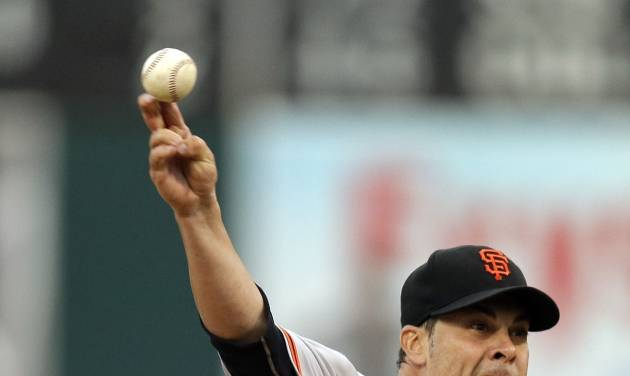 San Francisco Giants' Ryan Vogelsong works against the Oakland Athletics in the first inning of a baseball game Monday, July 7, 2014, in Oakland, Calif. (AP Photo/Ben Margot)