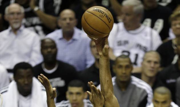 San Antonio Spurs' Tim Duncan (21) shoots over Miami Heat's Chris Bosh (1) during the first half at Game 3 of the NBA Finals basketball series, Tuesday, June 11, 2013, in San Antonio. (AP Photo/David J. Phillip)