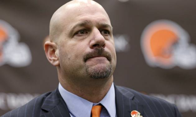Cleveland Browns coach Mike Pettine listens to a question during a news conference Thursday, Jan. 23, 2014, in Berea, Ohio. Buffalo's defensive coordinator, who met with team officials for the first time just a week ago, finalized a contract Thursday to become the Browns' seventh full-time coach since 1999. (AP Photo/Tony Dejak)