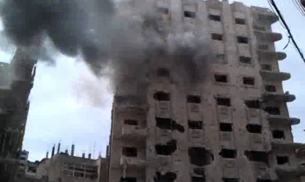 "This image made from amateur video and released by Bambuser Saturday, April 14, 2012 purports to show smoke from shelling in Homs, Syria. (AP Photo/Bambuser via AP video) THE ASSOCIATED PRESS CANNOT INDEPENDENTLY VERIFY THE CONTENT, DATE, LOCATION OR AUTHENTICITY OF THIS MATERIAL. TV OUT- MANDATORY CREDIT: ""BAMBUSER"""