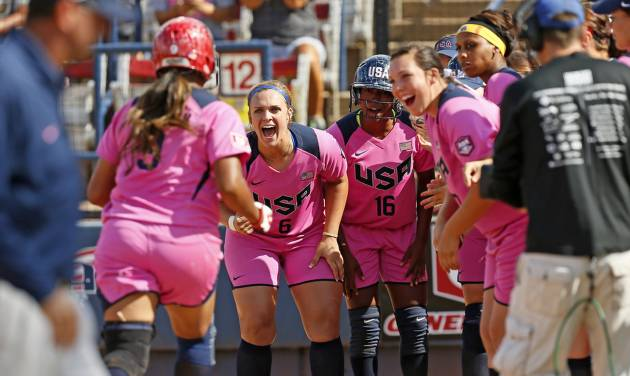 Amber Freeman (9) of the United States is greeted at home plate by her teammates after hitting a two-run home run to give the United States the lead in the third inning during a game in the World Cup of Softball between the USA and Puerto Rico at ASA Hall of Fame Stadium in Oklahoma City, Sunday, July 14, 2013. Team USA won, 10-3 in five innings. Photo by Nate Billings, The Oklahoman