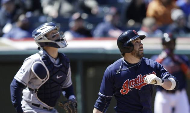 Cleveland Indians' Jason Kipnis, right, watches his ball after hitting a two-run home run off San Diego Padres starting pitcher Eric Stults during the sixth inning in the first game of a baseball doubleheader, Wednesday, April 9, 2014, in Cleveland. (AP Photo/Tony Dejak)