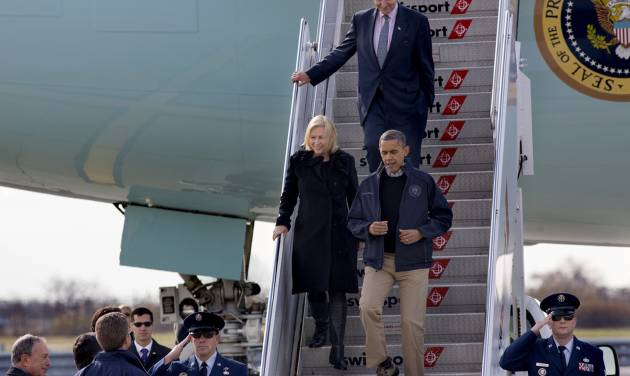 President Barack Obama, followed by Sen. Kirsten Gillibrand, D-N.Y, and Sen. Charles Schumer, D-N.Y., arrive at JFK International Airport in New York, Thursday, Nov. 15, 2012, before being greeted by New York City Mayor Michael Bloomberg, left, Housing and Urban Development Secretary Shaun Donovan, in HUD jacket, and other state, local and federal officials, before taking an aerial tour of damage along the New York coastline in the wake of Superstorm Sandy. (AP Photo/Craig Ruttle)