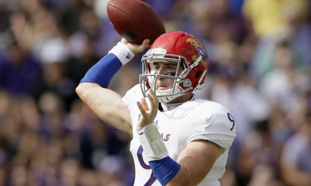 Kansas quarterback Jake Heaps (9) passes against TCU in the first half of an NCAA college football game, Saturday, Oct. 12, 2013, in Fort Worth, Texas. (AP Photo/Tony Gutierrez)