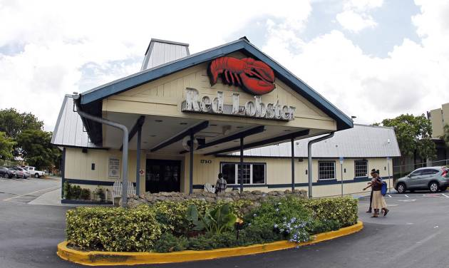 FILE - This Thursday, Sept. 6, 2012, file photo, shows a Red Lobster restaurant in Hialeah, Fla. Darden Restaurants on Friday, May 16, 2014 said it entered an agreement to sell its Red Lobster chain to investment firm Golden Gate Capital in a $2.1 billion cash deal. (AP Photo/Alan Diaz, File)