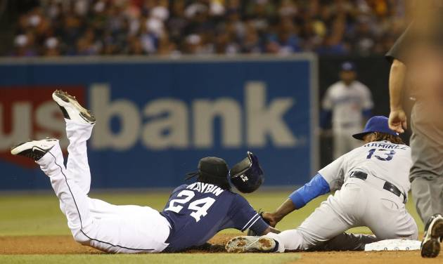 San Diego Padres' Cameron Maybin is picked off of second base as Los Angeles Dodgers' Hanley Ramirez makes the tag in the eighth inning of a baseball game Saturday, Aug. 30, 2014, in San Diego.  Maybin, who was pinch running, was picked off  by Dodgers' catcher Drew Butera for the first out of the inning . (AP Photo/Lenny Ignelzi)