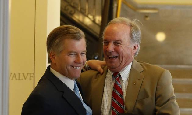 Virginia Gov. Bob McDonnell, left, and Sen. John Watkins, R-Powhatan, right, have a light moment  outside the Governor's office in the State Capitol in Richmond, Va. Thursday, Feb. 21, 2013. Watkins has been instrumental in getting a compromise on McDonnell's transportation bill. (AP Photo/Richmond Times-Dispatch, Bob Brown).