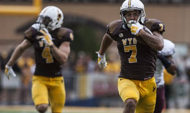 Wyoming's D.J. May runs in for a Cowboy touchdown as Wyoming hosted  Montana in a NCAA college football game on Saturday, Aug. 30, 2014, at War Memorial Stadium in Laramie, Wyo. (AP Photo/Casper Star-Tribune, Ryan Dorgan)
