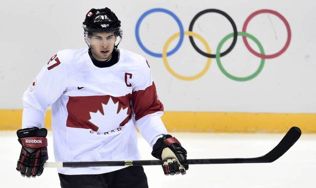 Canada's Sidney Crosby takes part in a warm-up ahead of quarterfinal hockey action against Latvia at the 2014 Sochi Winter Olympics in Sochi, Russia on Wednesday, Feb. 19, 2014. (AP Photo/The Canadian Press, Nathan Denette)