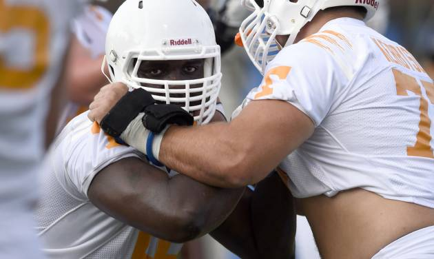 University of Tennesse offensive lineman Marques Pair, left, matches up against Kyler Kerbyson during the first football practice at Haslam Field, Friday, Aug. 1, 2014 in Knoxville, Tenn. (AP Photo/The Knoxville News Sentinel, Amy Smotherman Burgess)