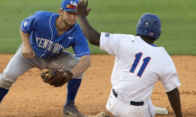 Florida's Josh Tobias is tagged out by Kentucky's Matt Reida on a steal attempt during the Southeastern Conference NCAA college baseball tournament Wednesday, May 21, 2014, in Hoover, Ala. (AP Photo/Hal Yeager)