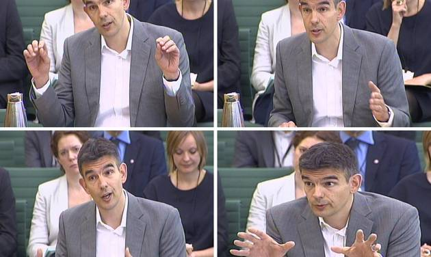 In these images taken from TV,  Google executive  Matt Brittin gives evidence to a parliamentary Public Accounts Committee on tax avoidance, in the Boothroyd Room, London Thursday May 16, 2013. Brittin  defended his company's complicated structure before Britain's Parliament, denying charges that it was misleading authorities to dodge paying tax. (AP Photo/PA) UNITED KINGDOM OUT