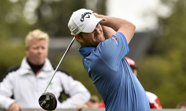 Scotland's Marc Warren watches his tee shot during the final round of the European Tour Golf Tournament in Himmerland, Denmark, Sunday, Aug. 17, 2014. (AP Photo/Rene Schutze, POLFOTO) DENMARK OUT