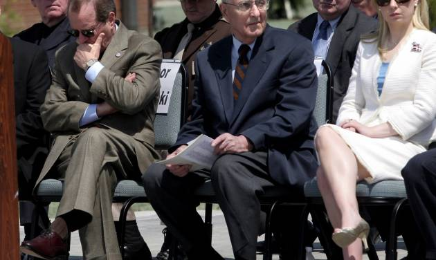 FILE - In this May 11, 2006, file photo, attending dignitaries including Oregon Gov. Ted Kulongoski, left, former Gov. Vic Atiyeh, center, and 2002 Miss America Katie Harmon sit, as the names of officers killed in the line of duty are read during the Oregon Law Enforcement Memorial ceremony at the new public-safety academy grounds in Salem, Ore. Atiyeh, Oregon's last Republican governor who shepherded the state through a deep recession during two terms in the 1980s, died Sunday, July 20, 2014, a family spokesman said. The former governor died at 8:15 p.m. PDT at Portland's Providence St. Vincent Medical Center of complications from renal failure, said Denny Miles, who had formerly served as Atiyeh's press secretary. He was 91. (AP Photo/Statesman-Journal, Thomas Patterson, File)