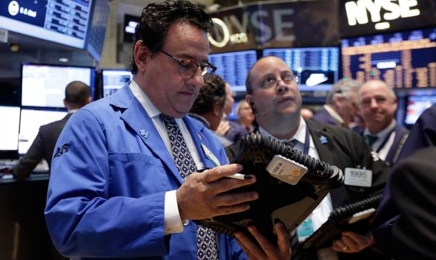 Peter Costa works with fellow traders on the floor of the New York Stock Exchange, Tuesday, April 22, 2014. Stock futures edged higher as more companies reported first quarter earnings. (AP Photo/Richard Drew)