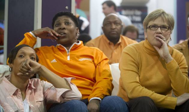 Tennessee head coach Holly Warlick, right, watches the selection show with assistant coaches, Jolette Law, center, and Kyra Elzy at the Women's Basketball Hall of Fame in Knoxville, Tenn. on  Monday, March 17, 2014. Tennessee received a no. 1 seed in the Louisville Regional of the NCAA Tournament.  (AP Photo/The Knoxville News Sentinel, Saul Young)