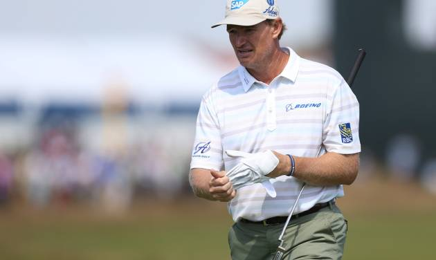 Ernie Els of South Africa waits to putt on the 5th green during the first day of the British Open Golf championship at the Royal Liverpool golf club, Hoylake, England, Thursday July 17, 2014. (AP Photo/Scott Heppell)