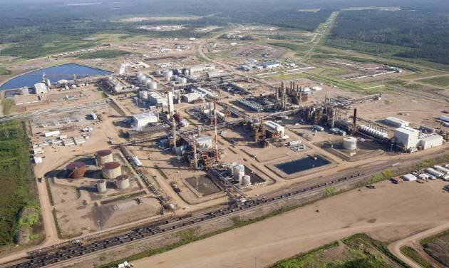 This Tuesday, July 10, 2012 aerial photo shows a Nexen oil sands facility near Fort McMurray, Alberta, Canada. On Friday, Dec. 7, 2012, Canada approved China's biggest overseas energy acquisition, a $15.1 billion takeover by state-owned CNOOC of Canadian oil and gas producer Nexen. (AP Photo/The Canadian Press, Jeff McIntosh)