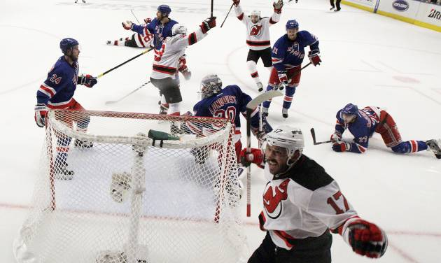 New Jersey Devils' Ilya Kovalchuk, bottom right, of Russia, reacts after scoring a goal against the New York Rangers in the first period of Game 2 of an NHL hockey Stanley Cup Eastern Conference final playoff series, Wednesday, May 16, 2012, at New York's Madison Square Garden. The Devils won 3-2. (AP Photo/Julio Cortez)