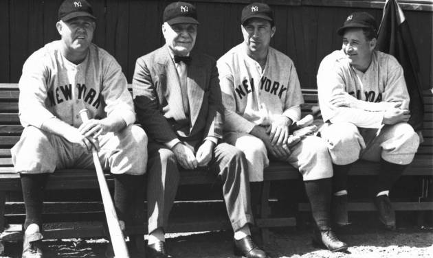 FILE - In this March 17, 1938 file photo, Col. Jacob Ruppert, second from left, owner of the world champion New York Yankees, sits with pitcher Paul Andrews, left, outfielder Ernie Koy and pitcher Bump Hadley, right, during spring training in St. Petersburg, Fla. Ruppert, longtime umpire Hank O'Day and barehanded catcher Deacon White were elected to the Hall of Fame on Monday, Dec. 3, 2012, for their excellence through the first half of the 20th century. (AP Photo/File)