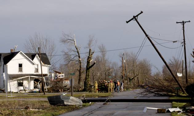 Residents of Marysville, Ind., survey the tornado damage to their homes Friday, March 2, 2012 in Marysville, Ind. Powerful storms stretching from the U.S. Gulf Coast to the Great Lakes in the north wrecked two small towns, killed at least three people and bred anxiety across a wide swath of the country on Friday, in the second deadly tornado outbreak this week. (AP Photo/Brian Bohannon)