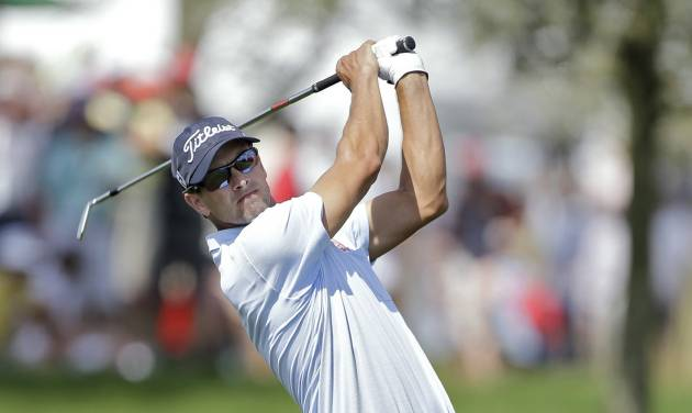 Adam Scott, of Australia, hits from the rough on the ninth hole during the second round of the Arnold Palmer Invitational golf tournament at Bay Hill Friday, March 21, 2014, in Orlando, Fla. (AP Photo/Chris O'Meara)