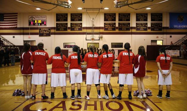 The Dover girl's basketball team lines up during the national anthem after Dover's Senior Night before a basketball game at Cashion, Tuesday, Feb. 2, 2016. Photo by Bryan Terry, The Oklahoman
