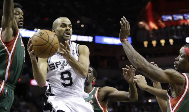 San Antonio Spurs' Tony Parker (9), of France, drives between Milwaukee Bucks' Larry Sanders,left, and Marquis Daniels, right, during the first quarter of an NBA basketball game on Wednesday, Dec. 5, 2012, in San Antonio. San Antonio won 99-95. (AP Photo/Eric Gay)