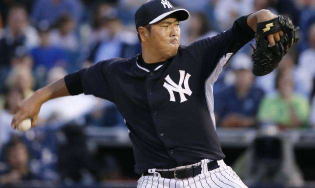 New York Yankees starting pitcher Hiroki Kuroda delivers in the second inning of a spring exhibition baseball game against the Miami Marlins in Tampa, Fla., Friday, March 28, 2014. (AP Photo/Kathy Willens)