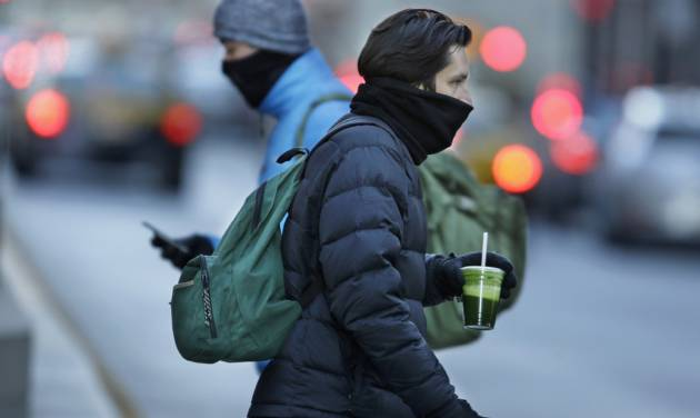 Commuters bundle up against extreme cold conditions Tuesday, Jan. 22, 2013, in Chicago. Temperatures in the area were hovering around zero with sub-zero wind chill reading hitting 10 below. Forecasters say waves of frigid Arctic air began moving over the region Saturday night Jan. 19, 2013. (AP Photo/M. Spencer Green)