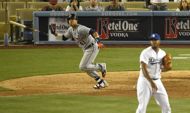 Detroit Tigers' Victor Martinez, left, tosses his bat as he hits a solo home run as Los Angeles Dodgers relief pitcher Kenley Jansen, right, looks on during the 10th inning of a baseball game, Wednesday, April 9, 2014, in Los Angeles. (AP Photo/Mark J. Terrill)
