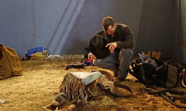 Chad Alesky of Monroeton, Pa., prays before the start of the National Circuit Finals Rodeo at the State Fair Arena, Saturday, April 6, 2013. Photo by Bryan Terry, The Oklahoman