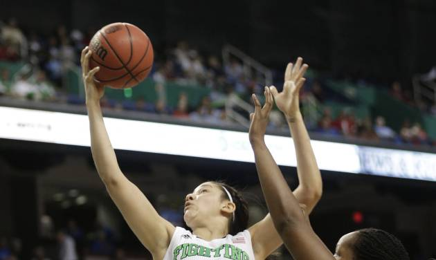 Notre Dame's Natalie Achonwa, center, shoots as North Carolina State's Jennifer Mathurin, right, and Kody Burke, left, defend during the second half of an NCAA college basketball semifinal game at the Atlantic Coast Conference tournament in Greensboro, N.C., Saturday, March 8, 2014. Notre Dame won 83-48. (AP Photo/Chuck Burton)