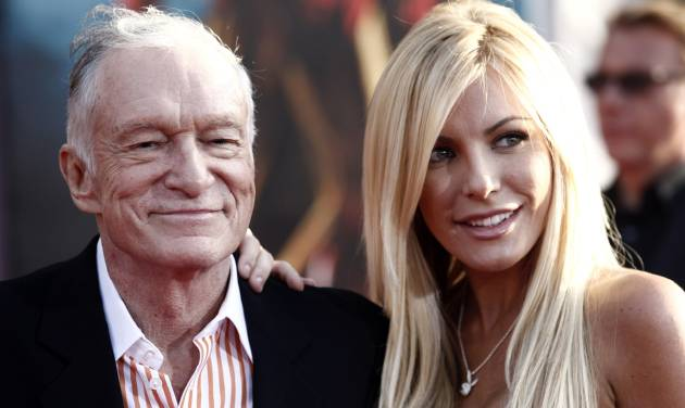 "FILE - In this April 26, 2010 file photo, Hugh Hefner, left, and Crystal Harris arrives at the premiere of ""Iron Man 2"" at the El Capitan Theatre in Los Angeles. The 86-year-old Playboy magazine founder exchanged vows with his ""runaway bride,"" Crystal Harris, at a private Playboy Mansion ceremony on New Year's Eve. Harris, a 26-year-old ""Playmate of the Month"" in 2009, broke off a previous engagement to Hefner just before they were to be married in 2011. (AP Photo/Matt Sayles, File)"
