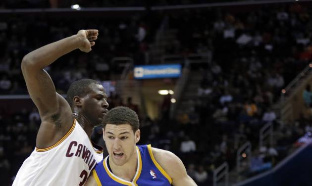 Golden State Warriors' Klay Thompson (11) drives on Cleveland Cavaliers' Dion Waiters during the first quarter of an NBA basketball game Tuesday, Jan. 29, 2013, in Cleveland. (AP Photo/Mark Duncan)