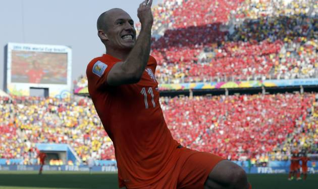 Netherlands' Arjen Robben after his teammate Memphis Depay scored their second goal during the group B World Cup soccer match between the Netherlands and Chile at the Itaquerao Stadium in Sao Paulo, Brazil, Monday, June 23, 2014. The Dutch team beat Chile 2-0 to top Group B. (AP Photo/Frank Augstein)