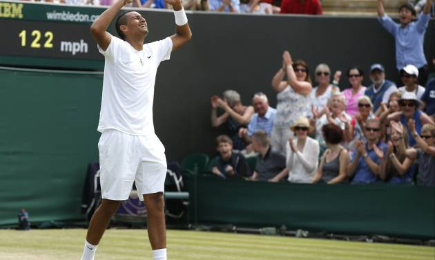 Nick Kyrgios of Australia celebrates after he defeated Richard Gasquet of France in a men's singles match at the All England Lawn Tennis Championships in Wimbledon, London, Thursday, June 26, 2014. (AP Photo/Alastair Grant)