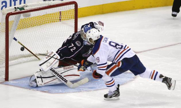 The stick of Columbus Blue Jackets goalie Sergei Bobrovsky (72) stops a shot by Edmonton Oilers' Sam Gagner (89) during the shootout in their NHL hockey game, Tuesday, March, 5, 2013, in Columbus, Ohio. (AP Photo/Mike Munden)